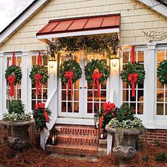 i want wreaths like this on every window for christmas