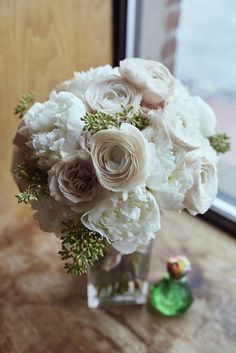 seeded eucalyptus and the palest blush Ranunculus give this traditional bridalbouquet a unique vibe
