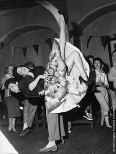 The Lindy Hop is famous for some of its over-the-head, around-the-body, under-the-legs crazy-acrobatic lifts and moves!