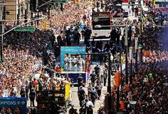 """We are a soccer nation,"" MLS Commissioner Don Garber tells the huge crowd that lined Broadway for a ticker-tape parade for the USWNT organised by New York City Mayor and fan Bill de Blasio. Photo via Alex Morgan. 12.07.15"