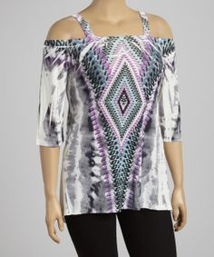 Make a style statement in this striking top. Its intricate print and sidetail hem give it standout appeal, while cutout sleeves show off shapely shoulders.
