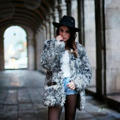 Dulceida wearing a faux fur coat by Mythe Clothing Baleeblu Market Place