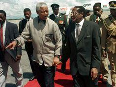Nelson Mandela with Robert Mugabe