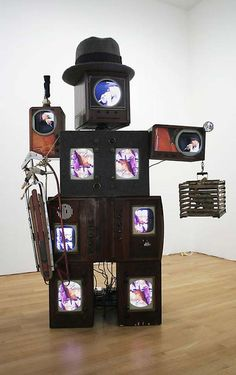 """Nam June Paik, """"Beuys Voice,"""" 1990, Two channel color video on laser discs, antique television cabinets, felt, mixed media sculpture, 104-3/8 X 74 X 37-3/8"""". The Gestalt principles explain why we see these stacked televisions as a figure."""