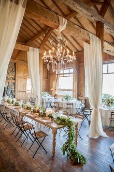 For those who prefer to have their favorite rustic wedding outside, a barn wedding could be the perfect solution. Barn wedding theme is becoming more and more popular as it not only saves so much c… Rustic Wedding Reception, Wedding Reception Centerpieces, Reception Ideas, Wedding Receptions, Wedding Barns, Tulle Wedding Decorations, Wedding Ceremony, Wedding Draping, Country Barn Weddings