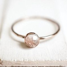 So feminine! This blush pastel pink Rose Quartz with it's rose-cut top on a slim gold band is a truly...