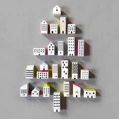 The magical season is coming... The count down is almost here!  Our Paper City Advent Calendar has 24 little boxes to house your treats