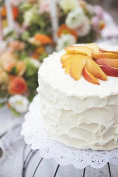 Peach topped wedding cake | Liz Anne Photography | see more on: http://burnettsboards.com/2014/09/peach-kumquat-sweet-southern-wedding/