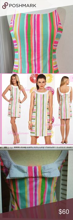 Lilly Pulitzer Darcy Spicy Stripe Shift Dress Lilly Pulitzer Darcy Multi Spicy Stripe Fluorescent Shift Dress. Size 4. Bow detail at back neckline. Shift shape with contrast neckline, slimming contrast side panel, and an adorably feminine bow on the scoop neck back. Hidden side seams zipper. Cotton poplin 100% cotton. Style number 51935. Ships from a non-smoking home. Lilly Pulitzer Dresses