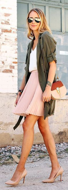 Army green parka with light pink skirt and heels — a combination like this is perfect for everyday wear or work.