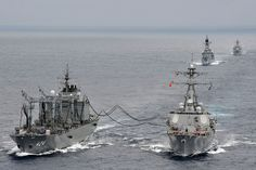 USS McCampbell conducts a replenishment at sea. by Official U.S. Navy Imagery, via Flickr