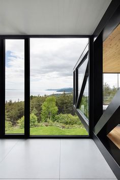 Black steel beams and plenty of glass in a contemporary Canadian whose design recalls in parts the work of Mies van der Rohe. Interior of contemporary residential home in Cap à l'Aigle, Canada. Chalet Blanche by ACDF Architecture. Simple yet full of creative details.