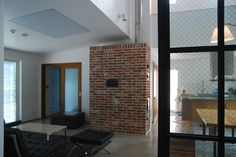 masonry heater in yongin S.korea by atworkshop.or.kr 용인 묵리에 설치된 축열식 벽난로. 바닥40평과 2층10여평 거실최고높이 약6m 공간을 난방함.