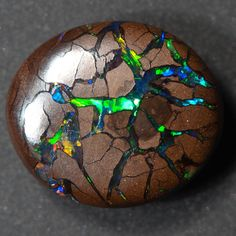 Boulder Opal: note to self, layer iridescent or holographic colours underneath cracked matt browns.