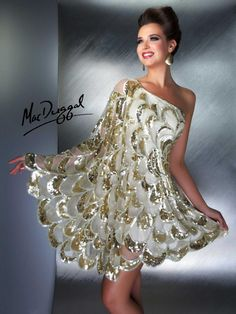 I want this dress! Fun, flirty and perfect for a fancy date night or fun night out.  Mac Duggal Couture