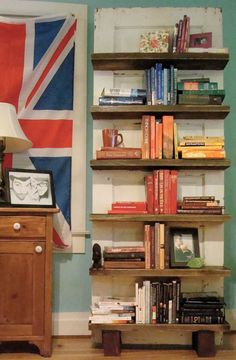Old door repurposed as a book shelf- This just may be the option for me :) I was really looking for a corner thing but I like this!