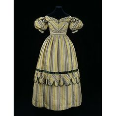 Gown made 1827-1829 from fabric woven ca. 1770 -1780