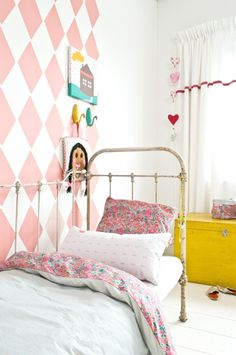 "Ok, I said I was avoiding pink. But I like this example best. Search harlequin walls.  Strong patterns are supposed to help the baby's brain and the can only see high contrast for a while. How about gray and white? With small black accents?   But how to reconcile ""rustic"" with is idea?"