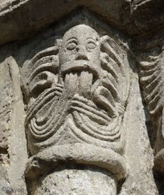 Green Man (12th Century) in the church at Bricquebec, Normandy, France (photo Claude Rayon©)