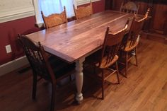 Custom 7' dining table. Walnut top with painted base.