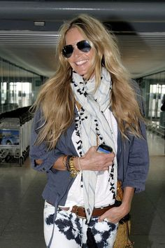 Elle Macpherson Catches A Flight Out Of Heathrow