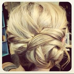 I like the weaving in the bun of this one, but I would want a more defined braid to the left going into it.