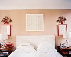 Bedroom - A white tufted headboard between a pair of wooden bedside tables