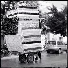A tall stack of #mattresses pulled down the street in #zanzibar, #tanzania #Padgram