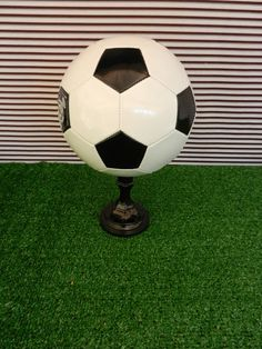 Soccer ball on a painted candlestick for centerpiece - clever! From Chocolates for breakfast: Soccer Party Fun