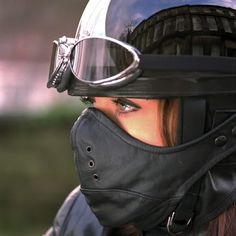 Helmet, mask, and goggles. Something about a woman with a helment on that is just sexy...