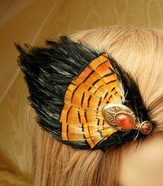 Black feather fascinator,Halloween fascinator,Thanksgiving fascinator, Pheasant feather fascinator,orange and black fascinator. $39.00, via Etsy.