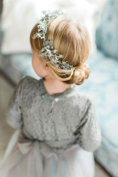 Adorable flower girl hair with crown.