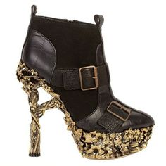 299 Another Alexander McQueen design. Very identifiable. Great bootie. I really like his uniqueness and fresh perspective. It wasn't instaneous though; it has had to grow on me though.