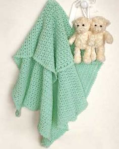 Easy crochet baby blankets are the best! The Marine Mint Baby Blanket is the perfect crochet project for the new crocheter as well as the seasoned crocheter who needs a quick pattern.