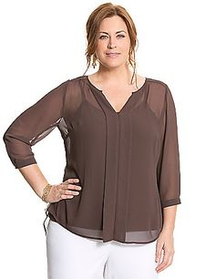 Wardrobe-essential sheer chiffon blouse gets a fresh twist with a pleated back and high-low hem for a modern silhouette. #LaneBryant