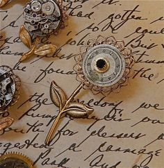 Steampunk flower brooch. Flowers in my garden. This listing is for 1 brooch. You could also attach it to chain and wear as a necklace. Vintage watch parts assembled with brass stamping made in the USA All parts are riveted together . Size 3 x 1 1/4 Chain is 24 The faces are