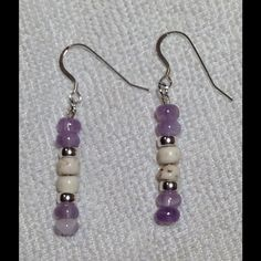 Natural amethyst and white turquoise earrings These lovely dangle earrings are made from genuine amethyst and white turquoise beads. There are also .925 silver spacer beads. The ear wires are also sterling silver. Be sure to view the matching bracelet in my closet! PeaceFrog Jewelry Earrings