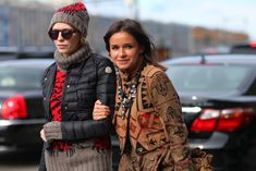 an amazing beige with navajo print short coat. the necklace doesn't hurt her either...