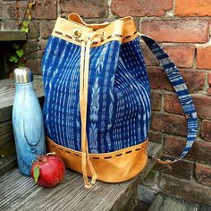 Our Corte Leather backpack, a fresh picked apple and a full of coffee is our way to beat the Monday morning blues. Monday Morning Blues, Guatemalan Textiles, Swell Bottle, Fair Trade Fashion, Sustainable Fashion, Leather Backpack, Bucket Bag, Autumn Fashion, Apple
