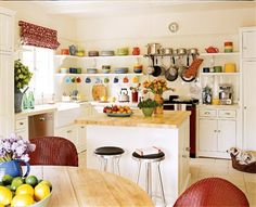 Ok... it's official, not only am I obsessed with the colour mustard, I also am clearly obsessed with colourful kitchens with painted furniture and open shelving. This is definitely the way to go fo...