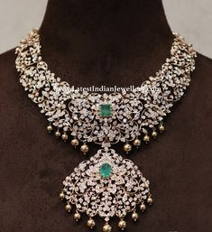 Statement diamond necklace from Ananth diamonds with single emerald stone and gold balls. Traditional bridal diamond necklace in heavy design. Indian Jewelry Sets, Bridal Jewelry Sets, India Jewelry, Bridal Jewellery, Latest Jewellery, Temple Jewellery, Handmade Jewellery, Jewellery Box, Diamond Necklace Set