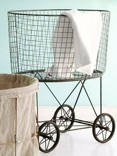 Vintage-inspired laundry hamper... I love the large wire basket and over-sized wheels