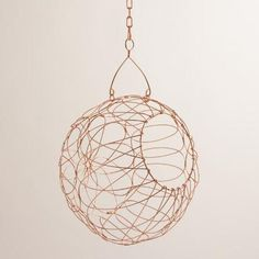 Hand-woven in India of iron with a warm copper finish, our exclusive round storage basket is functional wall art. This unique piece frees up counter space, adds an artistic touch to the kitchen and stores fruits and vegetables within easy reach.