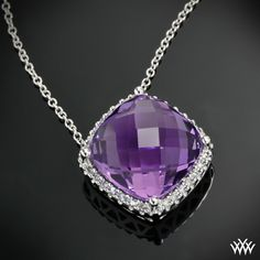 Amethyst and Diamond Pendant is set in 14k White Gold and holds a 6.98ctw Cushion Cut Amethyst.