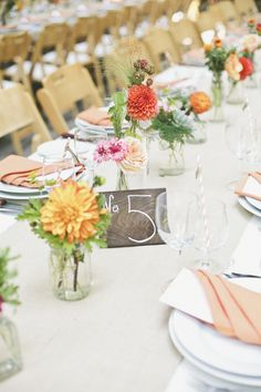#dahlia #centerpieces and hand painted wood table numbers | Photography: onelove photography - onelove-photo.com, Florals by http://www.poppystonedesigns.com, Design and Styling by http://asavvyevent.com  Read More: http://stylemepretty.com/2013/10/21/orange-themed-wedding-in-griffith-woods-from-onelove-photography/