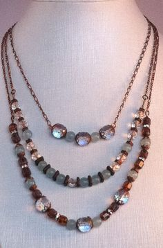 Multistrand necklace with Czech glass, coloured jade, Greek ceramic and copper beads and spacers.
