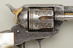 Close-up of Right side shows extent of wear to the finish - note extreme loss of gold from ejector rod housing at far right of picture.   Clearly this was a much-loved gun, and still is.  (Colt Single Action Army revolver, .44-40 cal.)