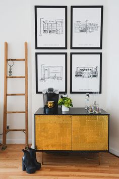 Prints of cool Nolita restaurants by the artist befittingly called Knowlita hang over a pretty gold console that stores booze and coffee.