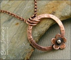 Hammered copper ring and flower necklace
