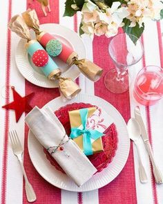 Christmas Decoration -- Stunning table-setting.  You can make everyone at your table feel much loved when you decorate it to give the message of Merry Christmas. Plan to have a matching tablecloth and napkin rings, and add a small gift in the same colour for each plate. Add a tea light for each setting, and a mass of flowers along the middle, maybe on a mirror runner, and your table will say, 'you're all very special.